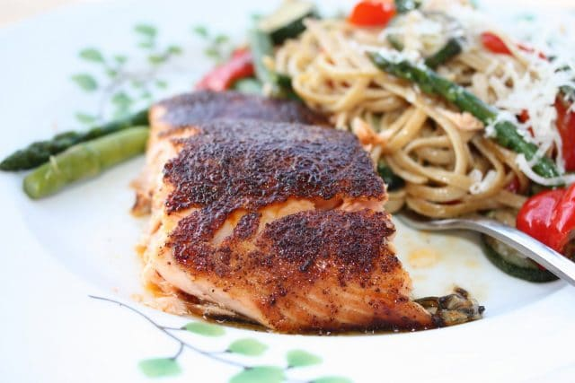 Broiled Salmon with Sweet Spicy Rub is the perfect recipe to introduce salmon to your family! Full of flavor, packed with protein & easy to make! An Ellie Krieger recipe via aggieskitchen.com
