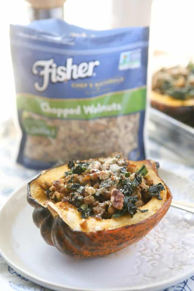 This Stuffed Acorn Squash is filled with hearty ingredients like sausage, kale & walnuts. Makes a wonderful dish for entertaining or even healthy meal prep! #ad #ThinkFisher @FisherNutsBrand