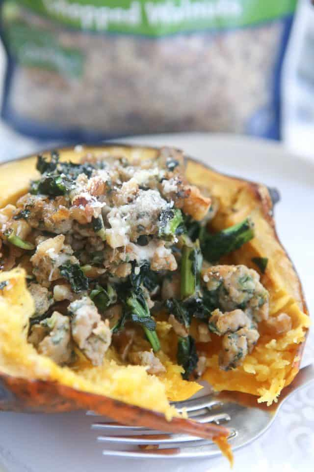 This Stuffed Acorn Squash recipe is filled with hearty ingredients like sausage, kale & walnuts. Makes a great dish for entertaining or healthy meal prep!