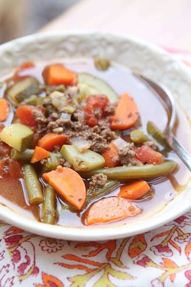 Break out the vegetables for this easy Italian Vegetable Beef Soup recipe. It's loaded with great vegetables like zucchini, squash and carrots. Healthy comfort food!