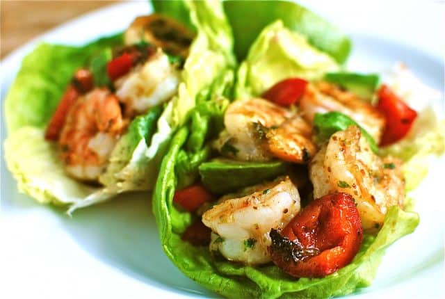 plate of two lettuce cups stuffed with shrimp, avocado, and peppers