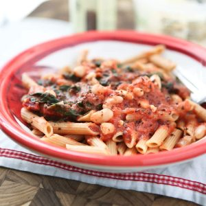 Swiss Chard with White Beans over Pasta - whole wheat pasta, greens and beans make this dish a hearty vegetarian pasta meal! Recipe via aggieskitchen.com