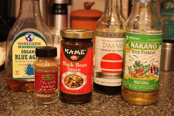 from left to right: organic blue agave syrup, five-spice powder, black bean sauce, tamari sauce, and rice vinegar