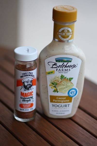 skinny jar of seafood seasoning and a container of caesar parmigiano yogurt dressing
