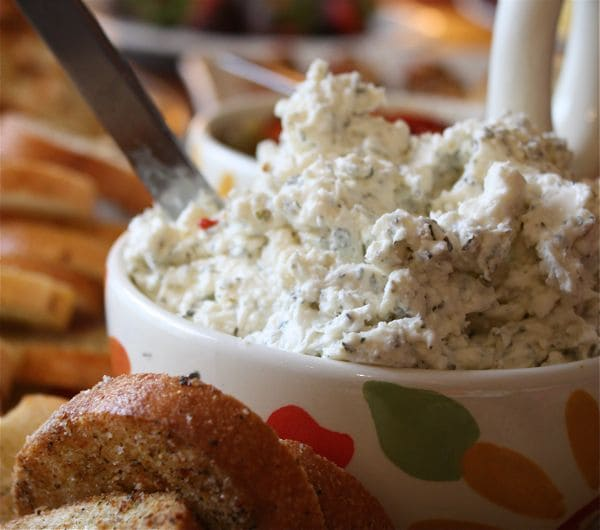 This Garlic Feta Herb Dip recipe is incredibly addictive. Great to serve at parties!