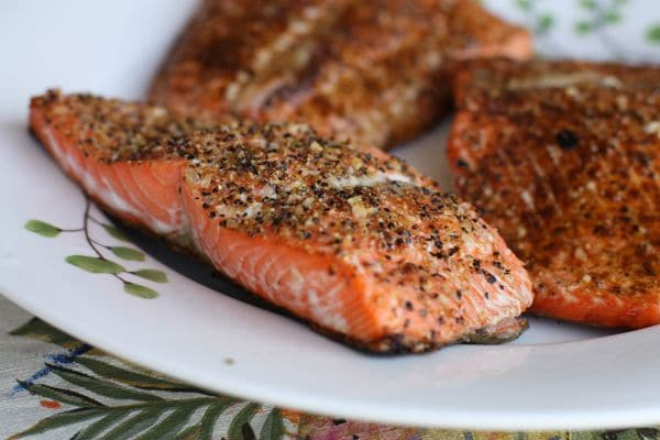 blackened salmon, cooked on the grill, resting on a plate