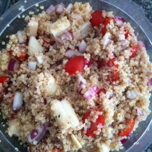 Toasted Garlicky Quinoa Salad with Tomatoes, Hearts of Palm and Goat Cheese