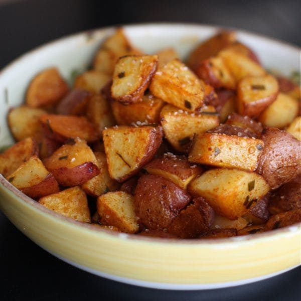 cubes of oven roasted red potatoes seasoned with smoked paprika in a large serving bowl