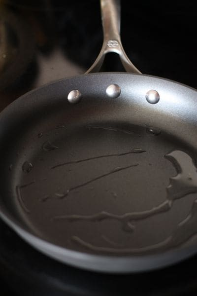 oil heating up in a skillet