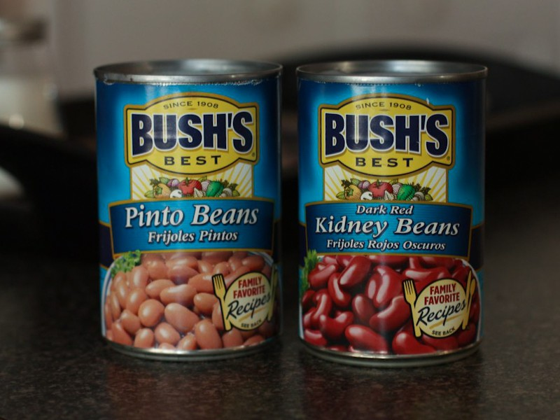 a can of Bush's pinto beans and a can of Bush's kidney beans