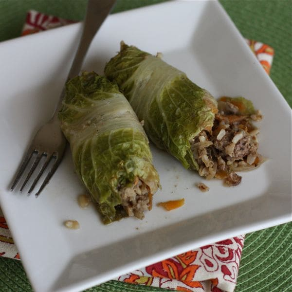 plate of stuffed cabbage rolls with fork laying on plate