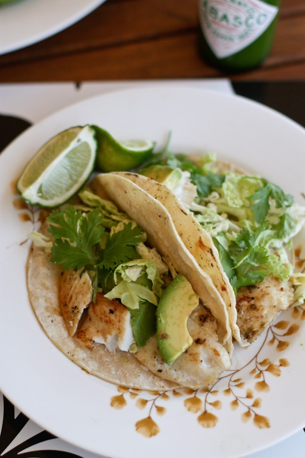 Light & bright these Grilled Fish Tacos simply seasoned with jalapeno, lime & cumin are perfect warm weather food! Don't skimp on the fresh green toppings!