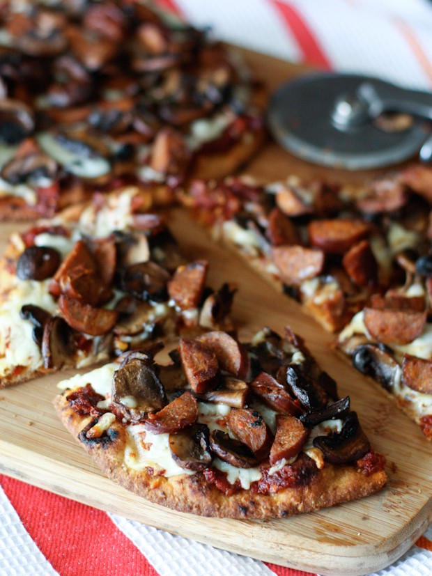 Andouille Sausage, Mushroom and Sun-Dried Tomato Naan Pizza | AggiesKitchen.com #pizza #mushrooms #sausage #flatbread