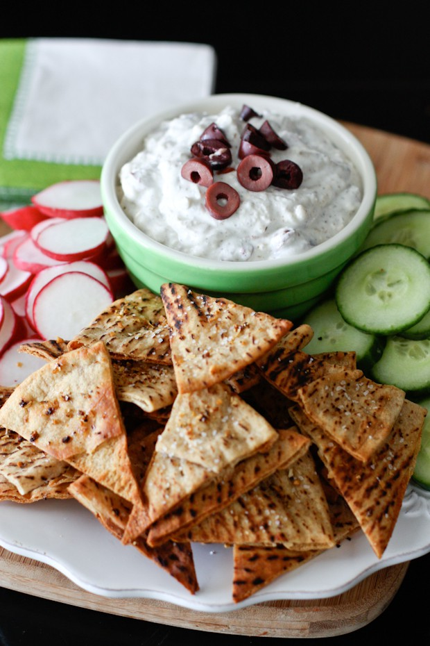A Greek yogurt based feta dip full of flavors of the Mediterranean! Perfectly paired with baked lemon pepper seasoned pita chips and fresh veggies.