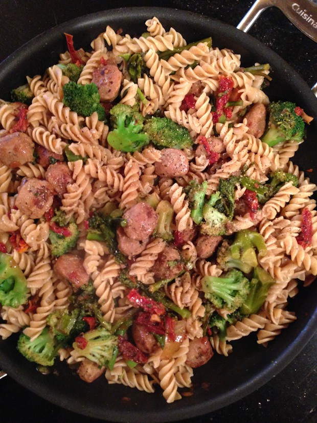 skillet with chicken sausage, sun dried tomatoes, broccoli florets, and whole wheat pasta