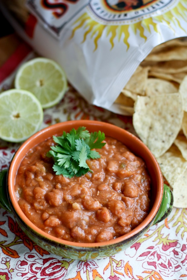 Homemade flavorful version of refried beans using a few shortcuts. This Drunken Refried Bean recipe is great for a side dish or to serve as a dip. Grab some tortilla chips and dig in!