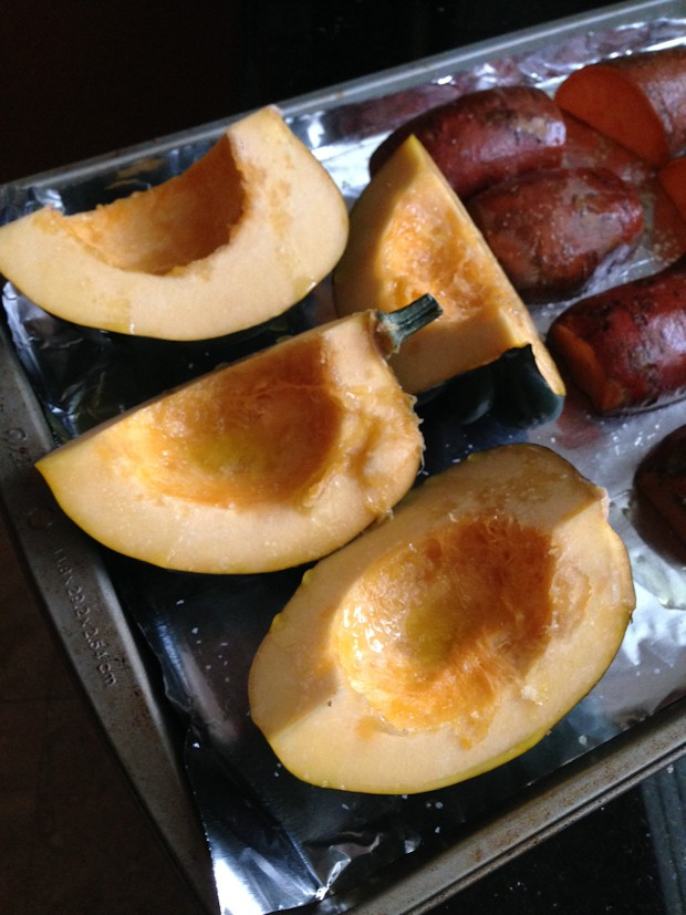 acorn squash wedges on a baking sheet before cooking