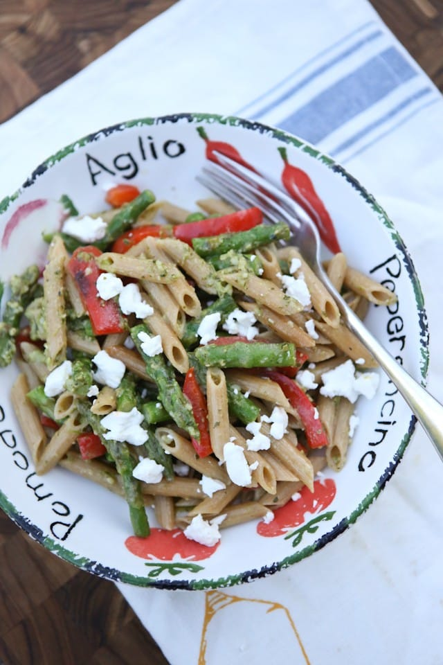 A delicious spring whole wheat pasta dish! Spring Vegetable Pasta with Pesto is bulked up with asparagus, red pepper and peas tossed in a light pesto sauce. Recipe via Aggie's Kitchen
