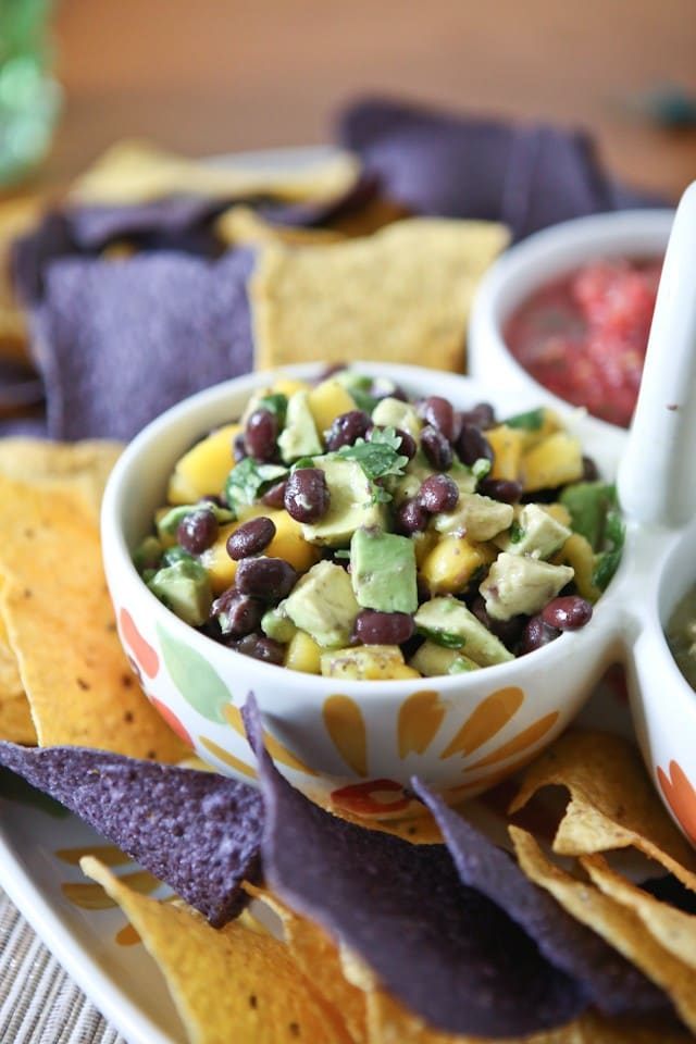 This Mango Avocado and Black Bean Salsa recipe is one you'll want to hang on to! Perfect for dipping with chips, in tacos or over grilled chicken. Recipe via aggieskitchen.com