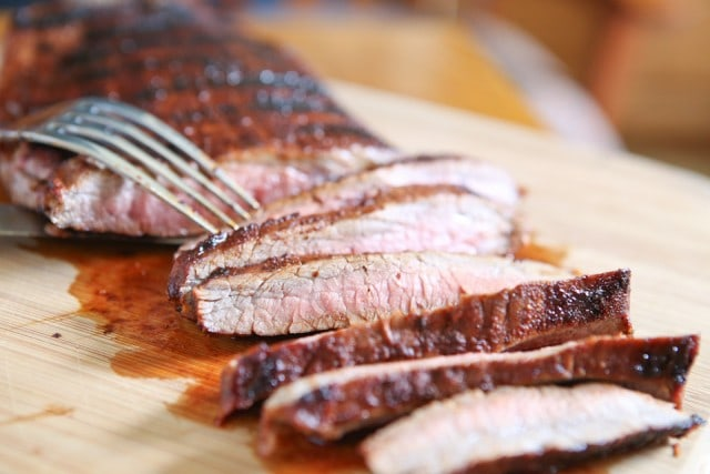Grilled Flank Steak seasoned with a flavorful blend of brown sugar, chili powder, smoked paprika & cinnamon - fire up your grill for this one this weekend!