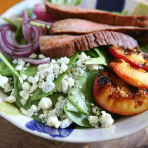 Steak Spinach Salad with Grilled Peaches and Red Onion