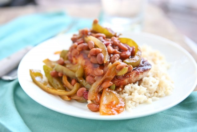 Grilled Pork Chops smothered in a special sauce made with baked beans, peppers and onions. So flavorful and an easy dinner to make - perfect for grilling season!