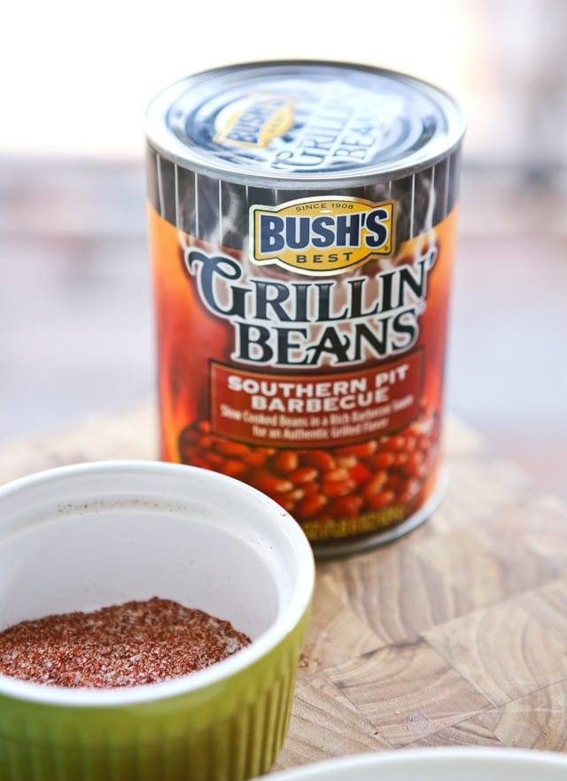 Smothered Grilled Pork Chops - Bush's Grillin' Beans help pull together this flavor yet simple and hearty meal. Your family will love it!