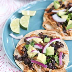 Slow Cooker Salsa Verde Pork Tostadas - all you need is a few ingredients and a little help from your slow cooker to put together this delicious, healthy baked tostada dinner your whole family will love.