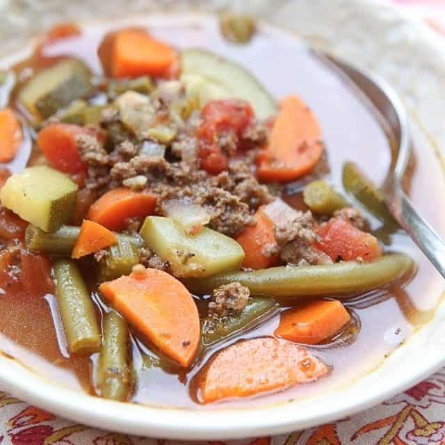 Break out the vegetables for this easy Italian Vegetable Beef Soup recipe. It's loaded with great vegetables like zucchini, squash and carrots. Healthy comfort food! #soup #vegetablesoup #beef #beefrecipe #souprecipe #lowcarbrecipe #healthysouprecipe #healthyrecipe