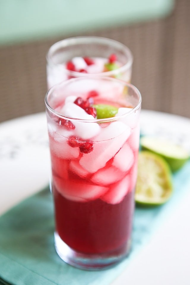 A festive way to bring in the holidays with seasonal pomegranate cocktails! Pomegranate, lime and rum - shaken not stirred! Cheers!