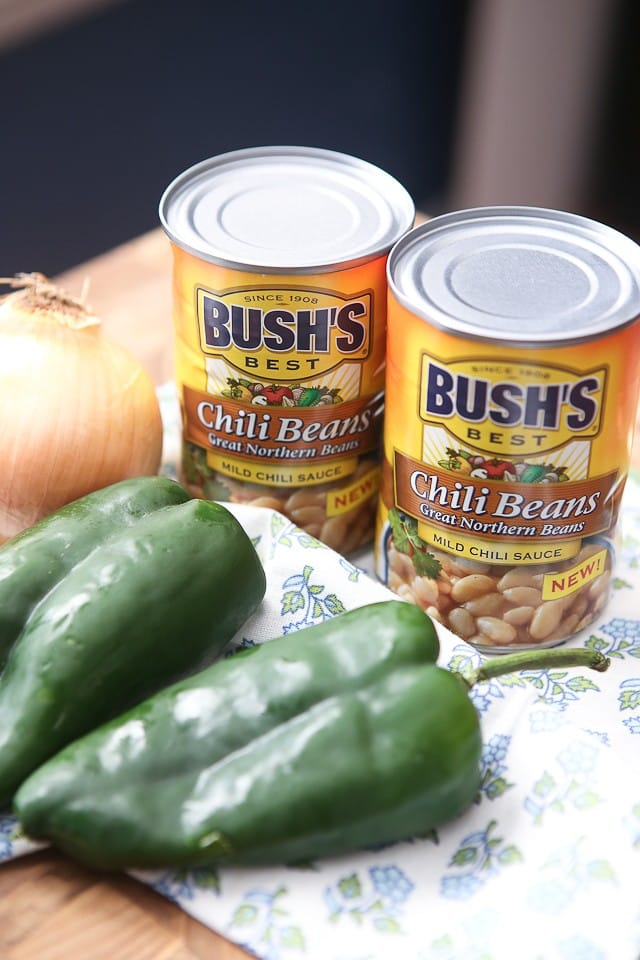 two cans of Bush's chili beans, a white onion, and two poblano peppers