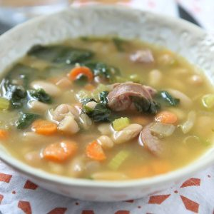 It's definitely soup season and one of my family's favorite soups is this Smoked Sausage, White Bean and Spinach Soup. Will warm you right up!