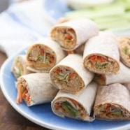 Lightened up party food! These Buffalo Hummus Chicken Salad Roll Ups are the perfect recipe to add to your next casual entertaining menu. Great for lunches too!