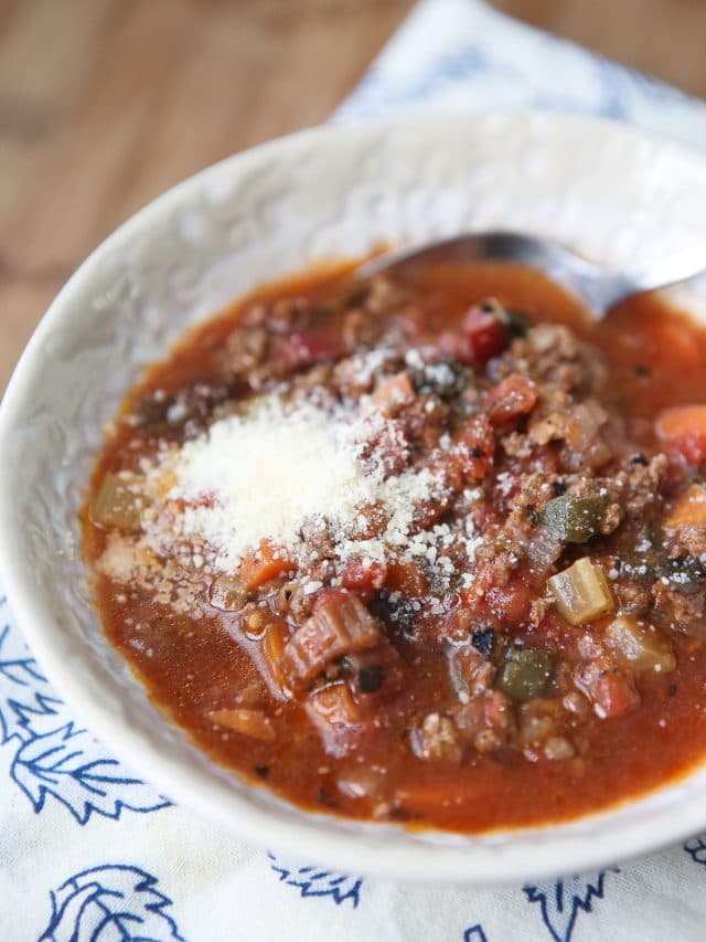 bowl of vegetable beef soup with parmesan cheese