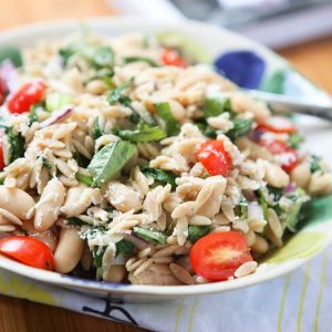 Orzo Salads are my favorite! This Tuna and Orzo Salad is packed with fresh spinach, tomatoes, Parmesan and basil - SO GOOD! Recipe from Andie Mitchell's Eating in the Middle: A Mostly Wholesome Cookbook, via aggieskitchen.com