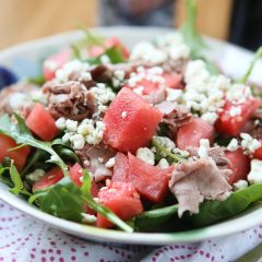 This salad screams summertime! Spinach and Arugula Salad with Watermelon, topped with sliced roast beef for protein - so easy to put together and enjoy for lunch or dinner. recipe via aggieskitchen.com