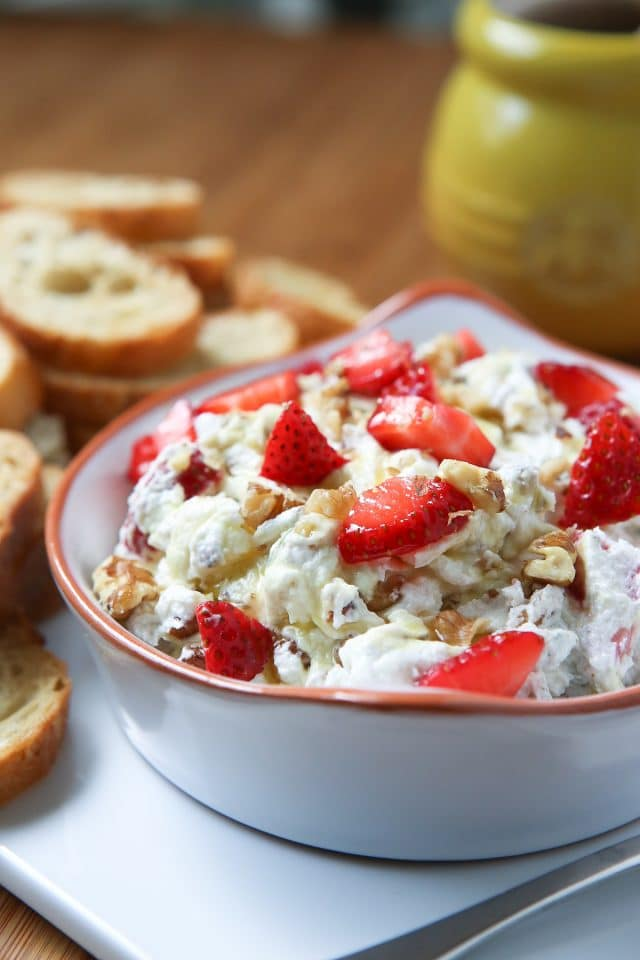 For your next summer get together! Strawberry Basil Goat Cheese Spread with Walnuts - served on crunchy toasts or crackers and drizzled with honey. So good! Recipe via aggieskitchen.com #FisherUnshelled