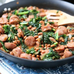 Easy comfort food your family will love! Baked Bean, Sausage & Kale Skillet - comes together fast, perfect for busy weeknights! Recipe via aggieskitchen.com