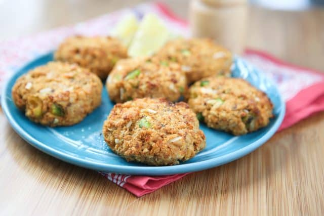 baked salmon cakes on blue plate