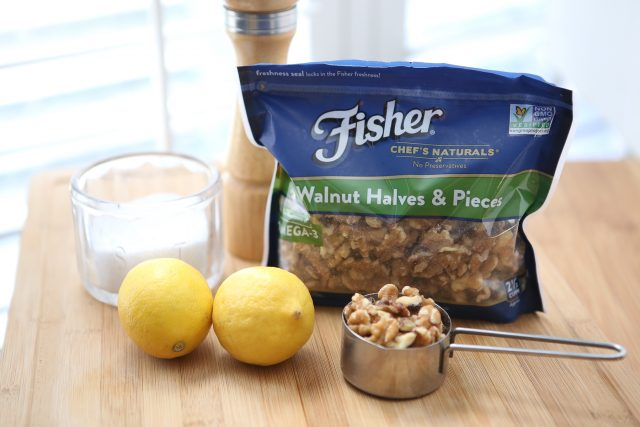 jar of salt, pepper grinder, two lemons, pack of Fisher walnut halves and pieces, and measuring cup of walnuts