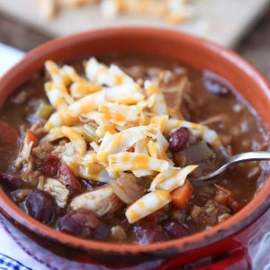 Warm up this winter with Slow Cooker Chicken and Farro Chili - so hearty & healthy, filled with veggies, lean protein, whole grains and Bush's Chili Beans. Recipe via aggieskitchen.com