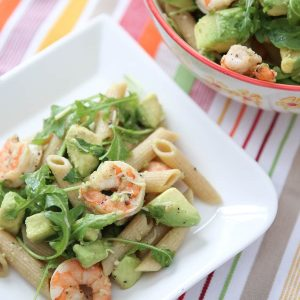 Roasted lemon pepper shrimp tossed with whole wheat pasta, plenty of creamy avocado, arugula, lemon and Parmesan - this Shrimp & Avocado Pasta is a heart-healthy dinner option perfect for any night of the week. Recipe via aggieskitchen.com