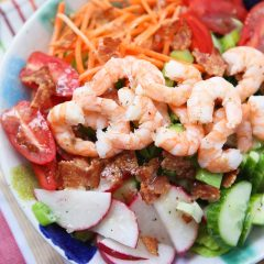 This Garden Salad with Shrimp and Bacon will definitely get you back in the salad! It's is chock full of the best crunchy, colorful veggies plus protein to fill you up and keep you feeling good.