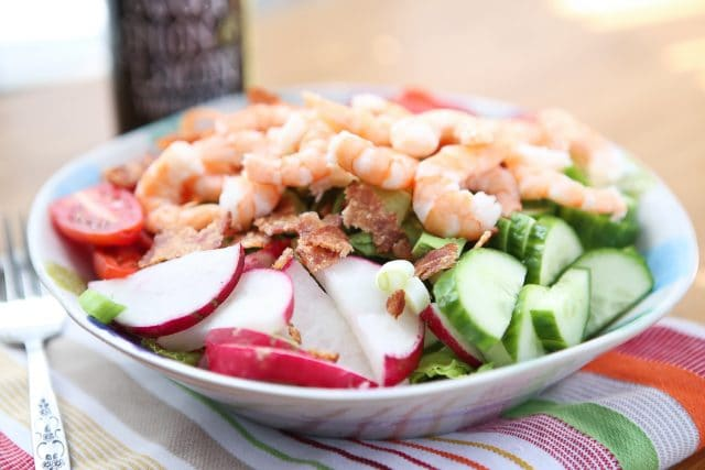 This Garden Salad with Shrimp and Bacon will definitely get you back in the salad! It's is chock full of the best crunchy, colorful veggies plus protein to fill you up and keep you feeling good. Recipe via Aggie's Kitchen