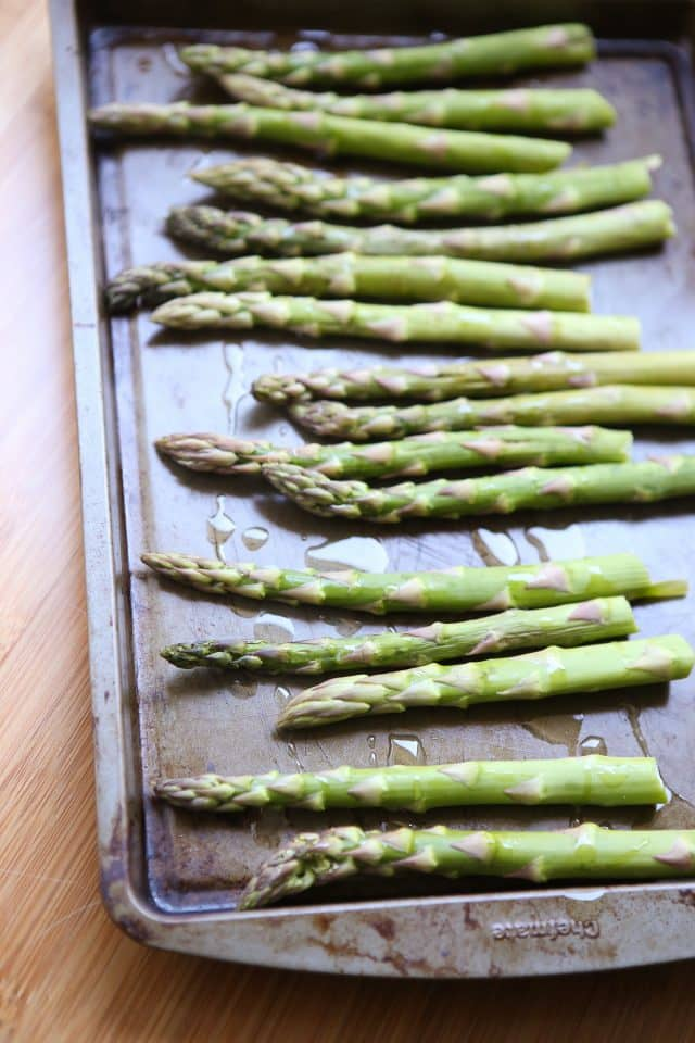 Roasted Asparagus is an easy way to get this spring vegetable favorite on the table at dinner time. Seasoned simply with just olive oil, salt and pepper and roasted to perfection.