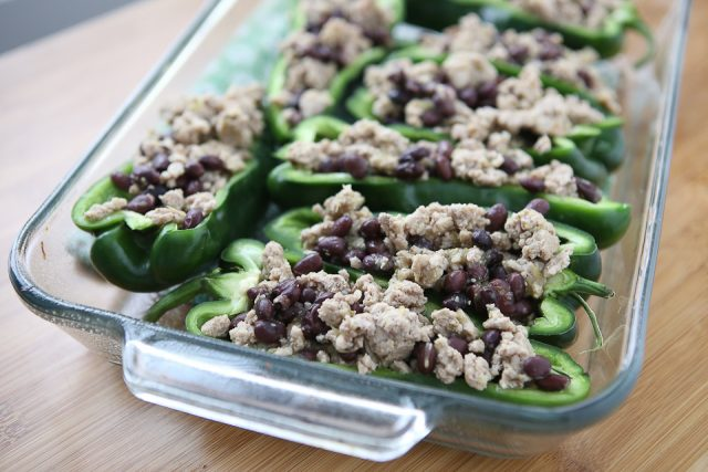 Only 5 ingredients to make these delicious Stuffed Poblano Peppers with Turkey and Black Beans! A light, healthy dinner perfect for weeknights. Leftovers make for great lunches too! Recipe via aggieskitchen.com