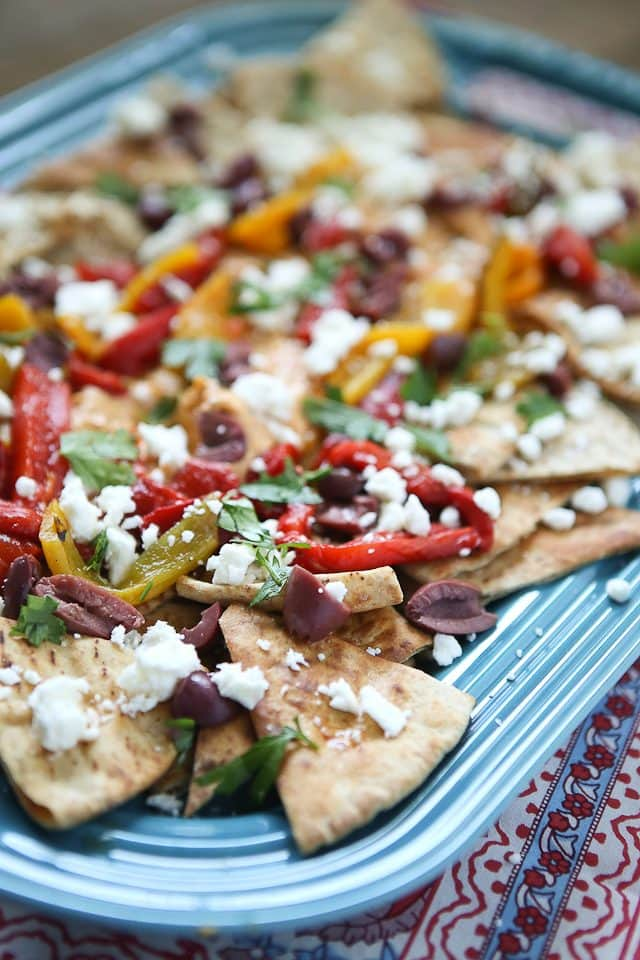 Say hello to your new favorite appetizer! Mediterranean Nachos with Roasted Red Pepper Hummus is what you could call a beautiful mess of all the flavors I love in this world. Topped with Sabra Hummus, roasted peppers, olives, feta and fresh herbs, you can't go wrong with this one! Recipe via aggieskitchen.com