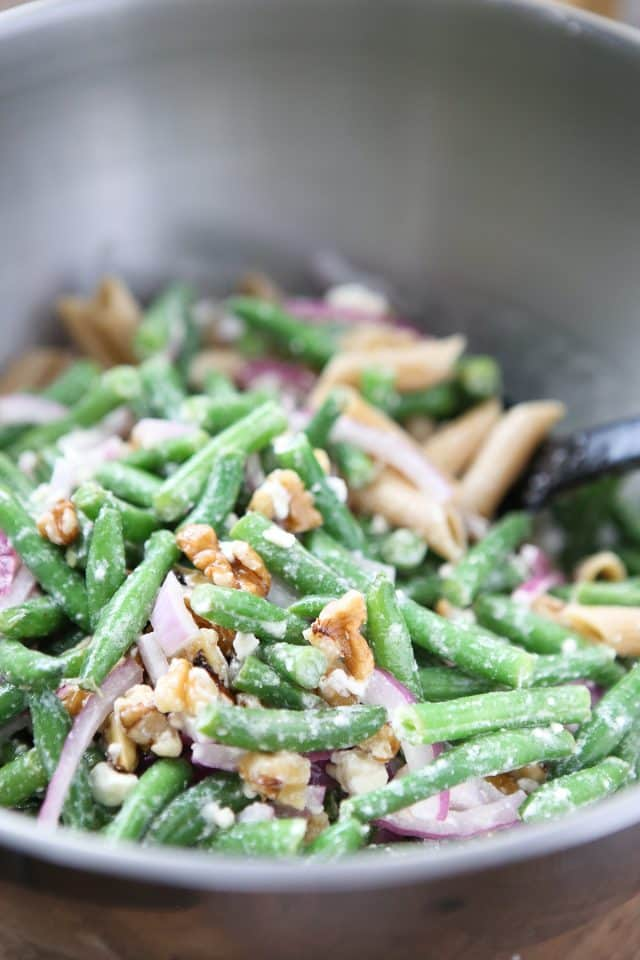 This Lemony Green Bean Pasta Salad with Walnuts is summer on a plate! Enjoy as light meal or vegetarian dish for your next barbecue or picnic.
