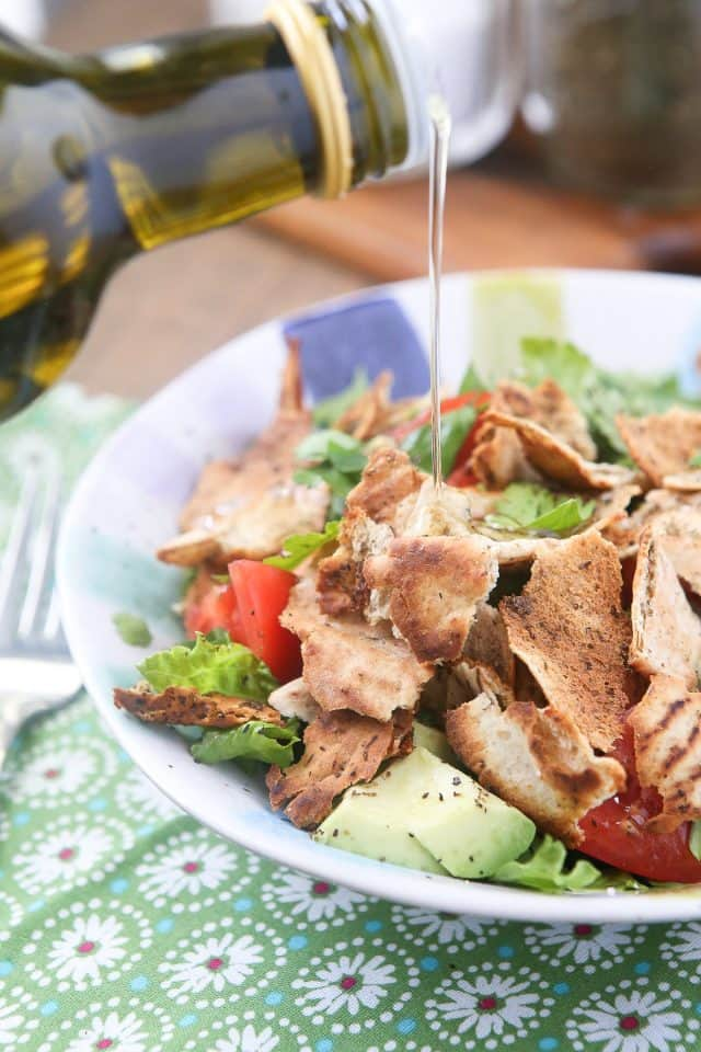 Lebanese-inspired Fattoush Salad filled with fresh garden vegetables, herbs & toasted pita pieces, dressed with lemon & olive oil.