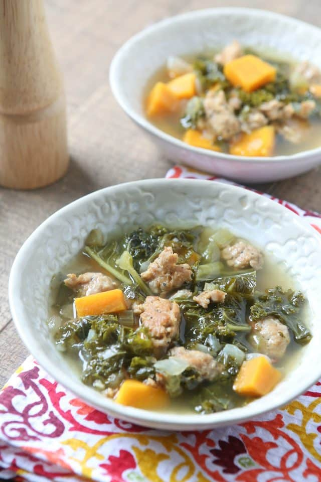 This Italian Sausage and Kale Soup with Sweet Potatoes is hearty yet perfect for a light fall dinner. Paleo friendly and low carb.